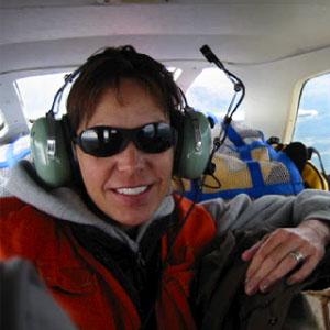 Dr. Cheryl Scott in small airplane over Alaska