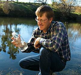 Dr. Rob Atwill sampling water