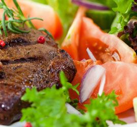 Steak and tomato on plate