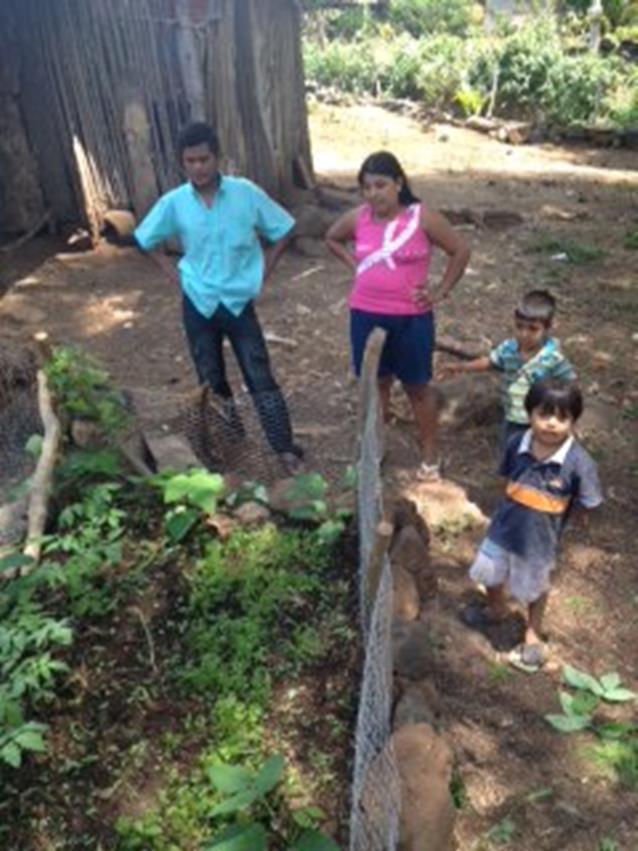 Family inspecting their garden in Ometepe