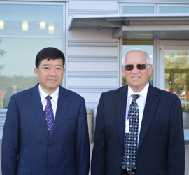 Ming Xu, Vice Governor, Jingsua Province, China and Dr. Bennie Osburn, Director, Outreach & Training, WIFSS