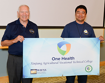 Xinjian Ag College One Health Club banner presentation at One Health for Food Safety Conference