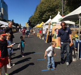 Boy at Farm-to-Fork Festival tosses bean bag