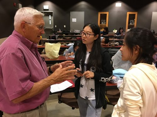 Dr. Bennie Osburn mentors students during One Health Conference