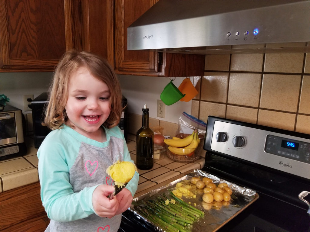 Amelia, daughter of Victor and Nicole Nisson of Davis, is having a great time helping prepare meals and learning important food safety steps.